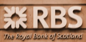 A Royal Bank of Scotland (RBS) sign is pictured outside a branch in central London on Oct. 7 in this file photo. The  RBS is a member of a group of European banks that are considered too large to fail.  (Carl  Court/AFP/Getty Images)